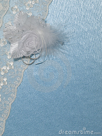 Background  blue silk with weddings rings and lace