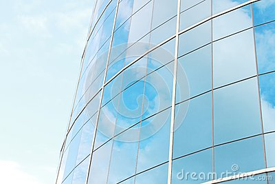 Background of blue sky reflect on glasses from  business buildin