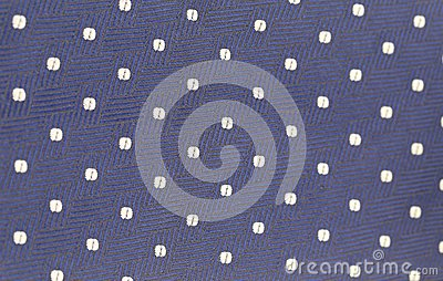 Background of blue tie with white speck.