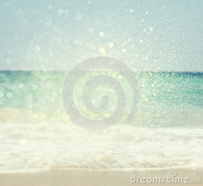Background of blurred beach and sea waves with bokeh lights, vintage filter