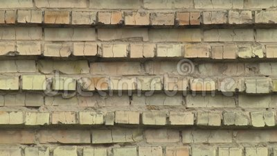 Background brick wall. Red brick wall as a texture background. High flat wall of an old building. Camera movement along the texture stock video footage