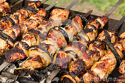 Background of crispy grilled kebabs on a BBQ Stock Photo