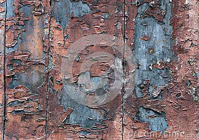 Wooden wall with flaking paint
