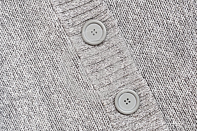 Background with Knitted grey with buttons