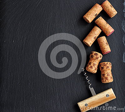 Free Background Of Several Wine Corks With A Wooden Cork Screw Royalty Free Stock Photo - 51587215