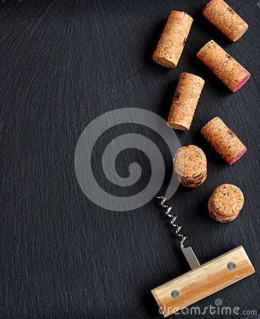 Free Background Of Several Wine Corks With A Wooden Cork Screw Stock Photography - 51588962
