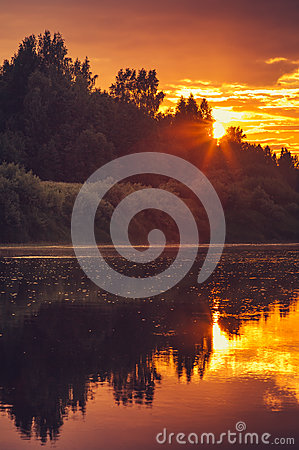 Free Background Of Sunset Sky And River Reflections Beautiful Scenery With Natural Colors Stock Images - 56730424