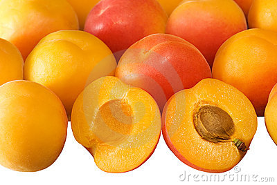 Background with ripe apricots on white