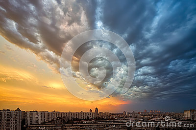 Background of a sunset storm clouds over cityscape