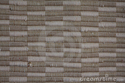 Background of woven beige and tan textile