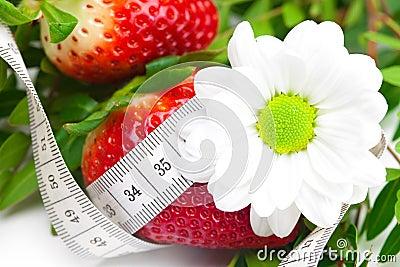 Backgroundbig juicy ripe strawberry and flower