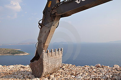 Backhoe digger by ocean