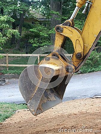 Backhoe digging dirt