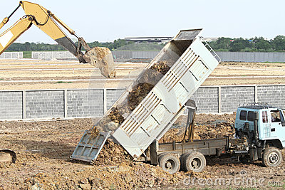Backhoe and dump truck