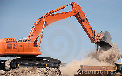 Backhoe Dumping Dirt