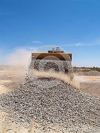 Backhoe Dumping Gravel