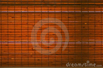 Backlit woven bamboo strips background