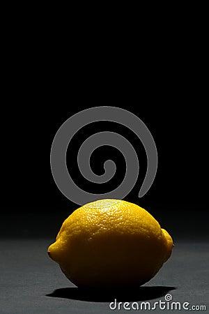 Backlit Yellow Lemon Fruit on Dark Black