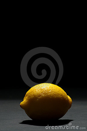 Free Backlit Yellow Lemon Fruit On Dark Black Royalty Free Stock Image - 1794236