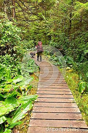 Backpacker on a boardwalk trail