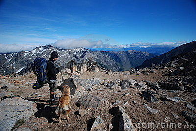 Backpacker and a dog in the outdoors