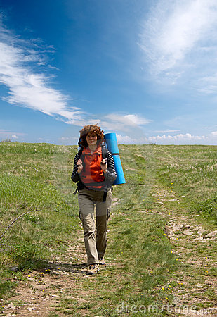 Backpacker girl hiking in crimea mountains