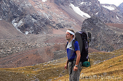 Backpacker in high mountain