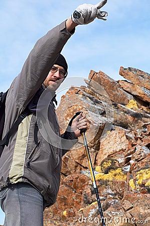 Backpacker in high mountain
