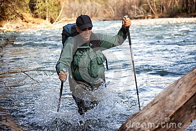 Backpacker and mountain river