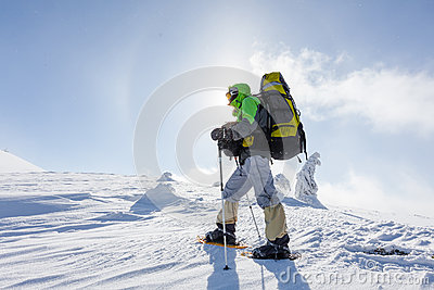Backpacker is posing in winter mountains Stock Photo