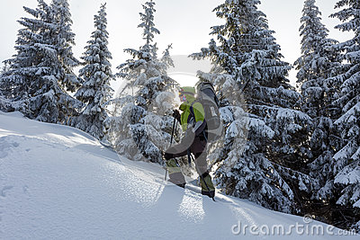 Backpacker posing in winter mountains Stock Photo