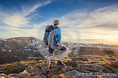 Backpacker on top of a mountaine