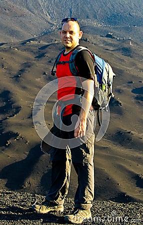 Backpacker on volcano Pacaya
