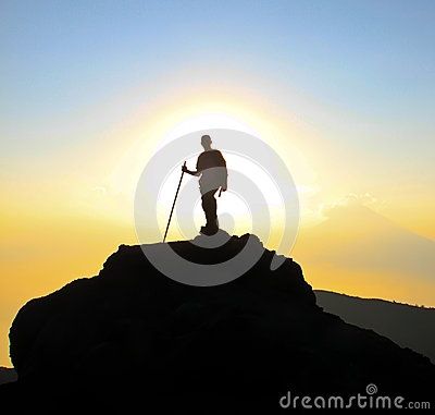 Free Backpacker With Walking Stick In Sunset Royalty Free Stock Images - 27225479