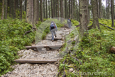 Backpacker women on mountain path - Tatra, Poland.