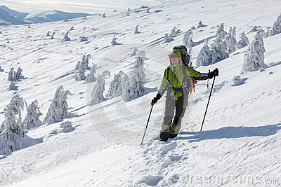 Backpacker woman posing in winter mountains Stock Photo