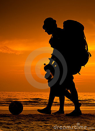Backpackers on the beach