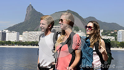 Backpackers tourists in Rio de Janeiro with Christ the Redeemer.