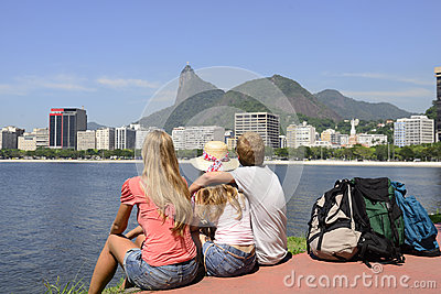 Backpackers tourists in Rio de Janeiro looking at Christ the Redeemer.
