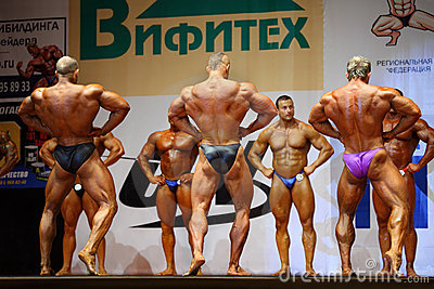 Backs of bodybuilders at Open Cup of bodybuilding Editorial Stock Photo