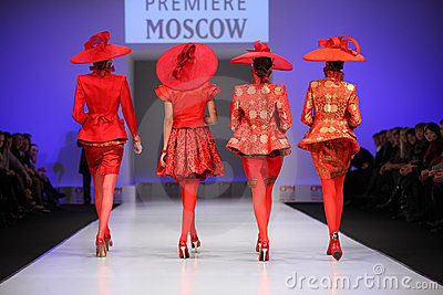 Backs of four women walk the catwalk Editorial Stock Photo