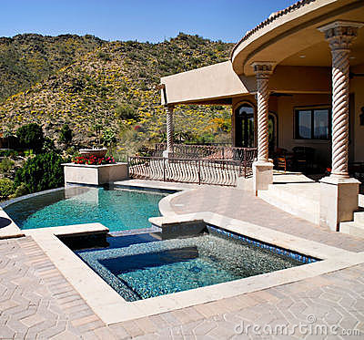 Backyard patio with pool and spa