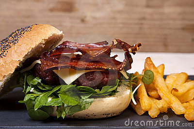 Bacon and cheeseburger with chips.