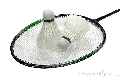 Badminton racquet with shuttlecock over white