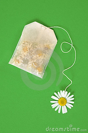Free Bag Of Chamomile Tea Over Green Background Stock Images - 21222064
