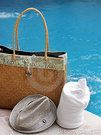 Bag and towel by pool