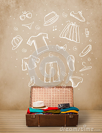 Bagagli del viaggiatore con i vestiti e le icone disegnati a mano