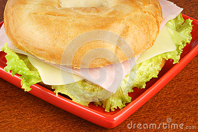 Bagel with ham, cheese and lettuce