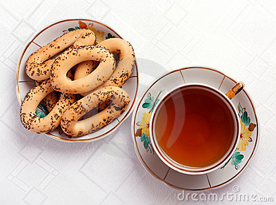 Bagels and a cup of tea on the tablecloth
