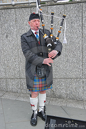 Bagpiper blowing his pipes, Edinburgh Editorial Stock Image